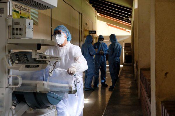 Nurse supervisor Nancy Maldonado moves monitoring equipment between rooms in the Juticalpa COVID-19 ward.