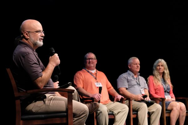 Glenn Newton, left, speaks during the panel discussion at the Harding University Bible Lectureship.