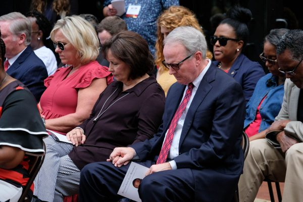 Friends and fellow Christians pray at the memorial dedication.