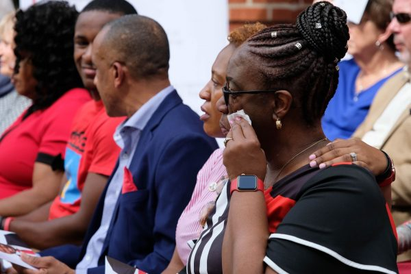 Allison Jean, right, wipes a tear at the dedication ceremony. Seated beside her, from right, are Botham Jean's older sister, Allisa Charles-Findley; his father, Bertrum Jean; and his younger brother, Brandt Jean.