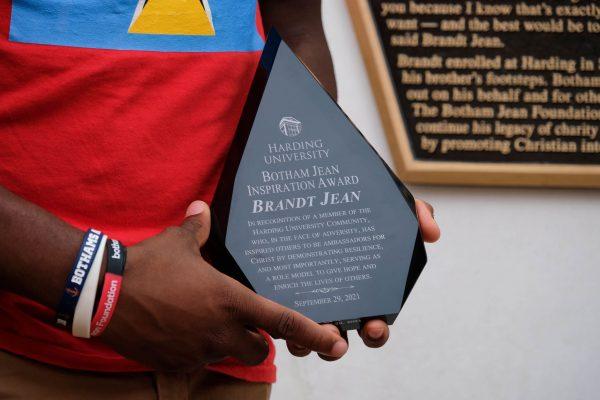 Brandt Jean holds the Botham Jean Inspiration Award.