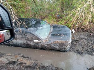 A vehicle near Jean Lafitte is submerged in mud.