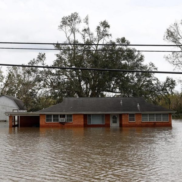 A house in Jean Lafitte is submerged in floodwaters.