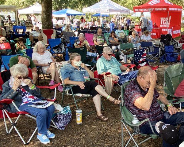 Attendees pray at the Carolina Bible Camp Bluegrass Festival in Mocksville, N.C.