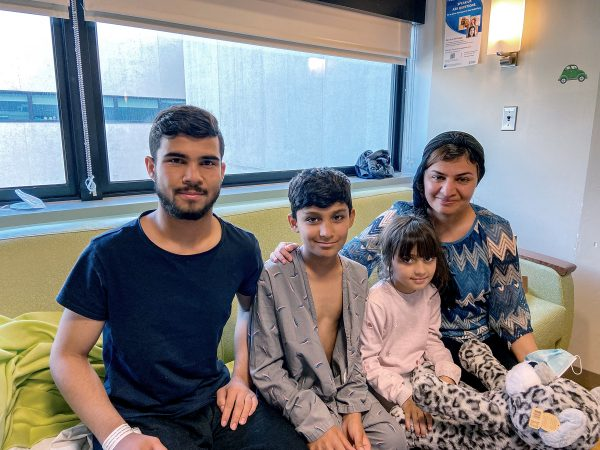 When a suicide bomber set off an explosion at the Kabul airport gate Aug. 26, the young nephew and niece of Ferishta, right, had been lifted over the gate. A 19-year-old neighbor from Kabul, left, found them and traveled with them to Walter Reed National Military Medical Center in Bethesda, Md.
