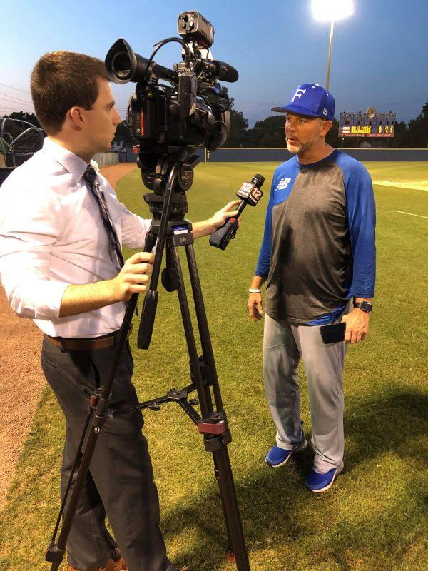 Faulkner University baseball coach Patrick McCarthy speaks with an interviewer.