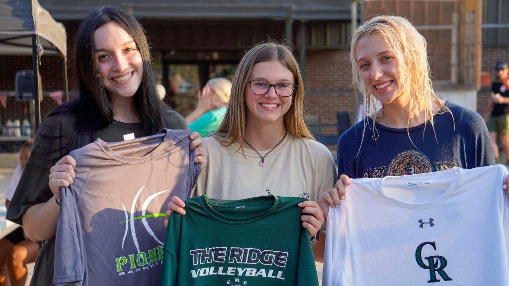Students pose with shirts supporting Crowley's Ridge College sports teams.