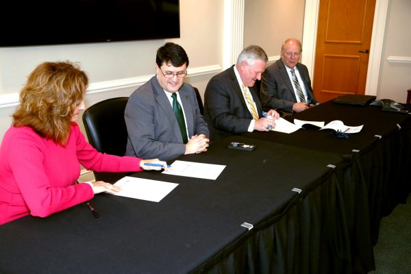 From left to right, Carole Medley, W. Kirk Brothers, Mike Williams and Dale Kirkland attend a memorandum signing on Faulkner University's campus Sept. 30.