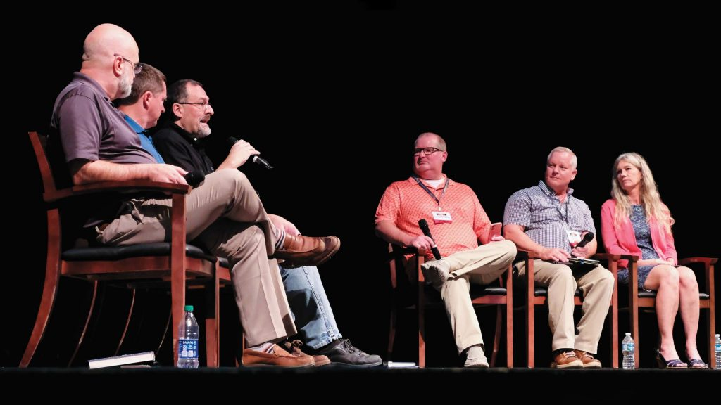 Carl Royster, third from left, makes a point during the Harding panel discussion.