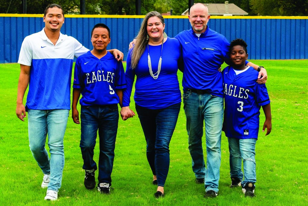 The McCarthy family — Miller, Andre, Katie Beth, Patrick and Keenan — at Faulkner's field.