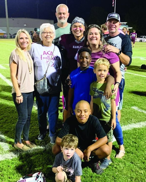 The extended family poses for a photo after one of Miller's Alabama Christian Academy football games.